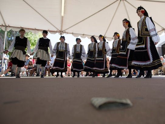 Students of the Pyrkagia dance group perform for the