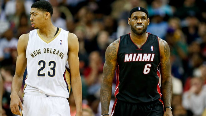 New Orleans Pelicans forward Anthony Davis and Miami Heat forward LeBron James walk up the court during the second quarter of a game last month at the Smoothie King Center.