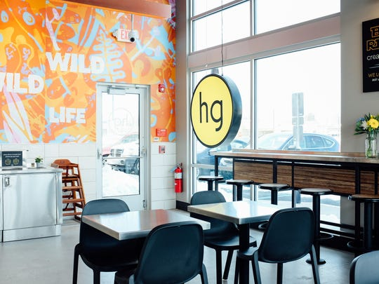 The interior of the new honeygrow in Marlton features a mural by Philadelphia-based artist and designer Tim Gough.