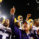 LSU head coach Les Miles celebrates a win over Sam Houston State after an NCAA college football game in Baton Rouge, La., Saturday, September 6, 2014. LSU won 56-0. (AP Photo/Jonathan Bachman)