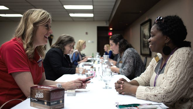 From left, Tamara Fitzgerld Ludwig with Fuddruckers and  Alicia Middleton with San Juan College participate in April 2016's Speed Networking event, hosted by the Farmington Chamber of Commerce.