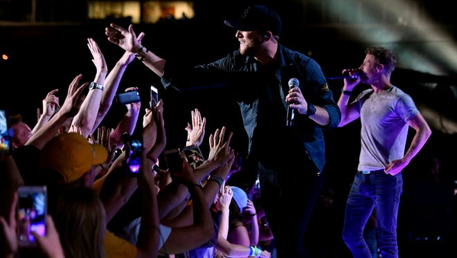 Cole Swindell interacts with the fans as he performs with Dierks Bentley at Nissan Stadium on the first day of CMA Fest 2017, on Thursday, June 8, 2017, in Nashville.