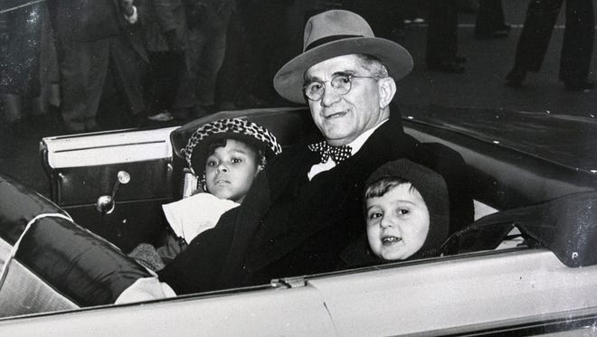 From the left, Margo Sexton, York Mayor Felix Bentzel and Paul Smith are shown around 1947 in a March of Dimes parade in York honoring the two children who were fighting the effects of polio.