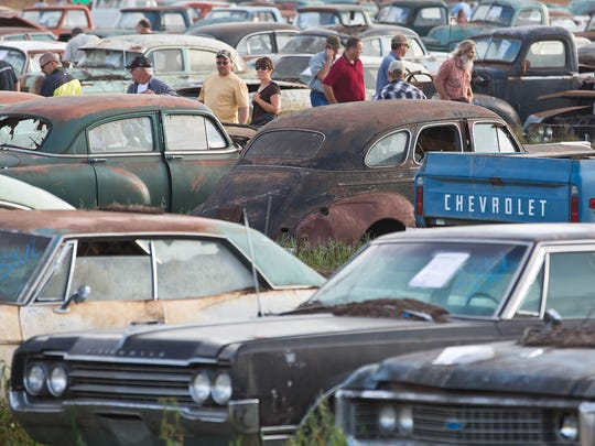 Potential bidders browse through some of about 500 vintage cars and trucks during a preview for an auction of former Lambrecht Chevrolet dealership vehicles in Pierce, Neb., on Friday Sept. 27, 2013.