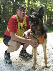 Richard Hunter and Klinger were paired in Guiding Eyes for the Blind's new pilot program that trains running guide dogs for visually impaired athletes.