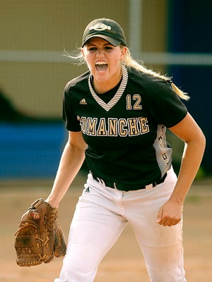 Comanche pitcher Madison Hagood (12) celebrates after the final out of the Maidens' 2-1 win over Colorado City in the Region I-3A championship game on Saturday, May 30, 2015, in Winters.
