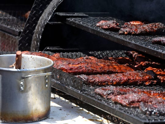 Ribs cook on the grill Saturday, March 17, 2018 during