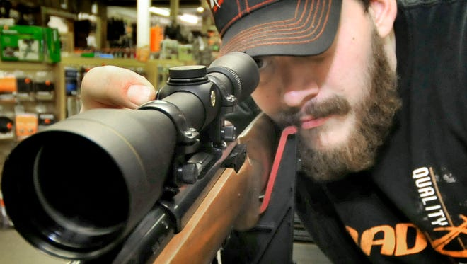 Ryan Wagaman caibrates a rifle scope Monday, Nov. 23, 2015 at Keystone Country Store, Fort Loudon. Rifle deer hunting nseason is just days away.