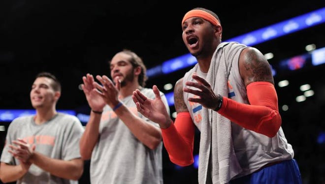 Knicks forward Carmelo Anthony, right, cheering on teammates during the Thursday, Oct. 20, 2016, preseason game against the Brooklyn Nets.
