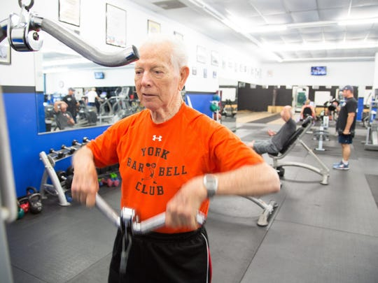 Frank Spellman does a regular weightlifting workout at Acceleration Fitness in Gulf Breeze. Spellman won an Olympic gold medal in the 1948 games.