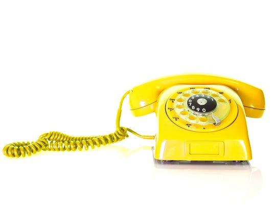 Antique yellow phone