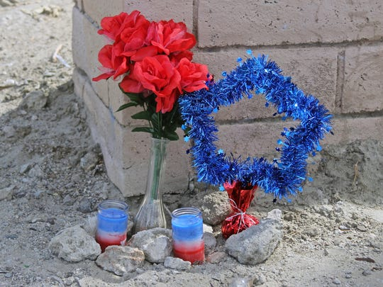 A shrine in the memory of Scot Breithaupt was arranged by the entrance of the lot in Indio where his body was found.