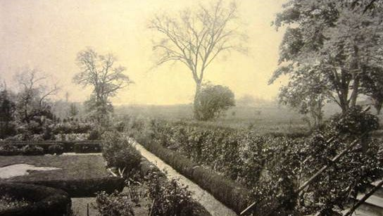 Photo of Jay Gardens circa 1905 with boxwood parterres and pebble paths
