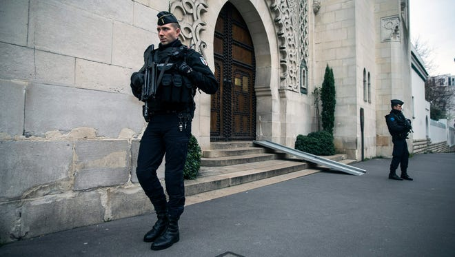 French officers of the gendarmery guard the entrance of the Great Mosque of Paris on Nov. 14, one day after a terrorist attack in Paris. On Dec. 2, police shut down 3 mosques in Paris suburbs for what authorities said was a 'pattern or radicalization.'