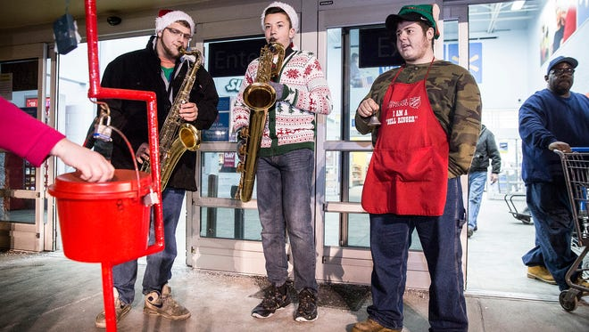 Ball State music students joined bell ringers to help raise funds for The Salvation Army outside of Wal-Mart on Thursday night. The Muncie branch of the SA was $56,000 short of its goal Thursday.