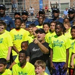 Garth Brooks to host invitation-only football camp in Sioux Falls