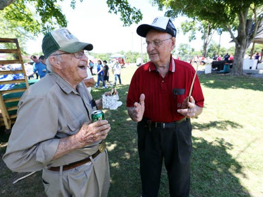 World War II veterans Fayne Haynes, right, and Frank