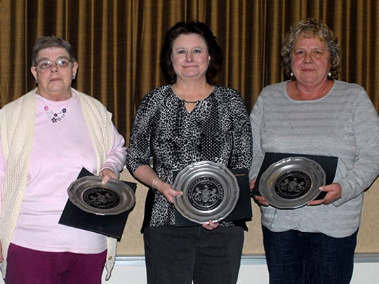 President Jody Harpster and 25-Year Service Award recipients Deb Rotz, Lisa Cline and Karen Carey.