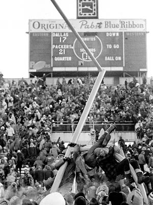 Fans climb on the goal post at Lanbeau Field in Green Bay, Dec. 31, 1967, after the Packers beat the Dallas Cowboys for the NFL Championship, 21-17. (AP Photo) ORG XMIT: APHS448505