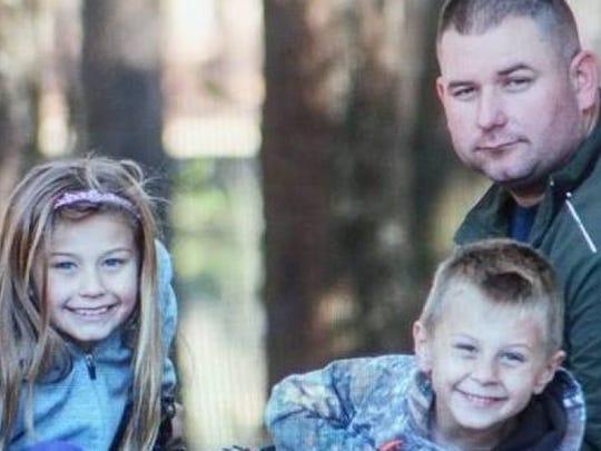 """Willard """"Truck"""" Truckenmiller with his two children."""