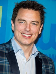John Barrowman seen here at a CW Network event in 2014 in New York attended a Pride rally in Palm Springs this week.