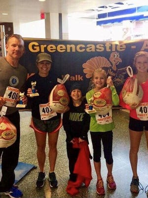 The Kiser family, from left, Chris, Penny, Kylen, Camryn and Cadie, poses for a photo after the 2015 Greencastle Turkey Trot. Penny calls running the Turkey Trot a family tradition.