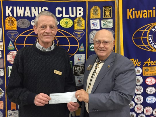 Golden K Kiwanis President Al Nelson, right, presents