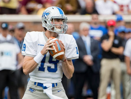 MTSU backup quarterback John Urzua (19) drops back
