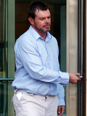 Eric Jensen leaves the federal courthouse in Denver on Sept. 26, 2013, after a hearing on charges of introducing adulterated food into interstate commerce.