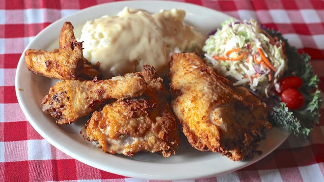 Rooster's Fried Chicken and Spirits in La Quinta serves the Junior Coop, a four-piece fried chicken entrée served with mashed potatoes and country style coleslaw.
