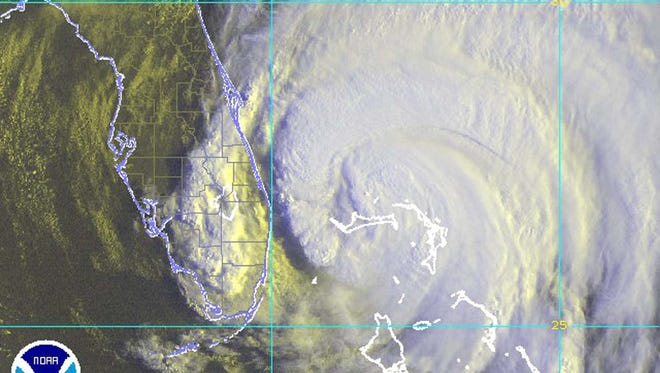 Copyright 2003 Florida Today AP Hurricane Frances is shown in this NOAA satellite image taken at 8:15 a.m. EDT on Sept. 4, 2004, as the large storm moves closer to the Florida coast line. Hurricane Frances is shown in this NOAA satellite image taken at 8:15 a.m. EDT on Sept. 4, 2004, as the large storm moves closer to the Florida coast line.