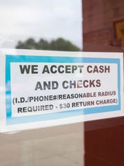 Carole Hinders accepts only cash at her Arnolds Park