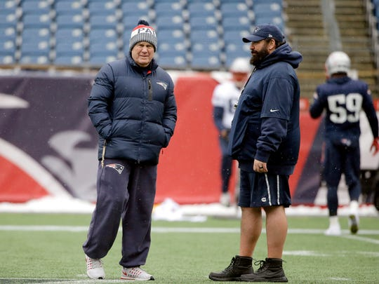 Patriots head coach Bill Belichick, left, speaks with