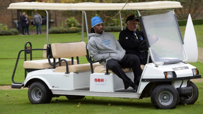 Detroit Lions cornerback Rashean Mathis rides in a cart during practice at the Grove.