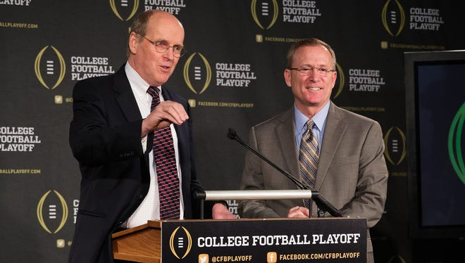 College Football Playoff executive director Bill Hancock (left) and chairman of the playoff selection committee Jeff Long, shown here last October, unveiled playoff voting protocols Wednesday.
