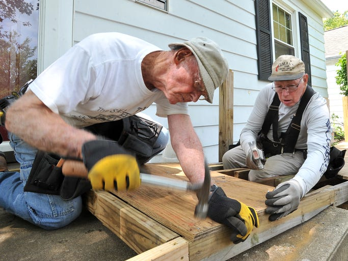Bill Voelkel, left, from Columbus, and Donald Walker, from Reynoldsburg, drive nails into a ramp they are building at Bev SeymourÕs home, Tuesday, July 29, 2014, in Lancaster. Voelkel and Walker are volunteers with the  Small Maintenance and Repair Team from the Church of the Redeemer United Methodist Church in Columbus.
