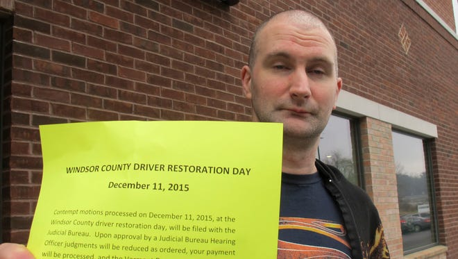 Rosco Adams of Brownsville, Vt., holds up paperwork he received on Friday Dec. 11, 2015 in White River Junction, Vt., as part of the process that will allow him to get his driver's license back. Hundreds of Vermont motorists whose drivers' licenses have been suspended were in White River Junction for the drivers' license restoration program that allows them to get their licenses back for a fraction of the amount they owe in fines and fees. The program is designed especially for low-income Vermonters who cannot afford the fines and end of breaking the law repeatedly.