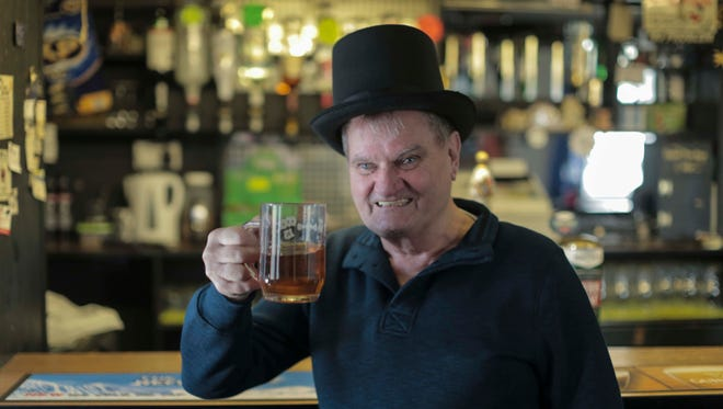 """Tony Kerby raises a pint in the documentary """"Dark Horse,"""" about a group of pals who breed a racehorse."""