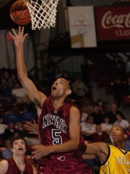 Greg Avery scores 25 points during a Division I district