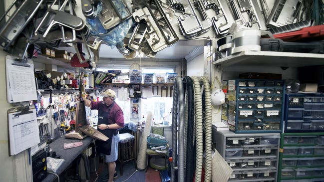 Dwayne Woodring is surrounded with spare parts as he works on a vacuum cleaner at Miller Brothers Vacuum Cleaner Hospital at 357 W. Philadelphia St. in York. The building has housed a vacuum repair business since 1928.