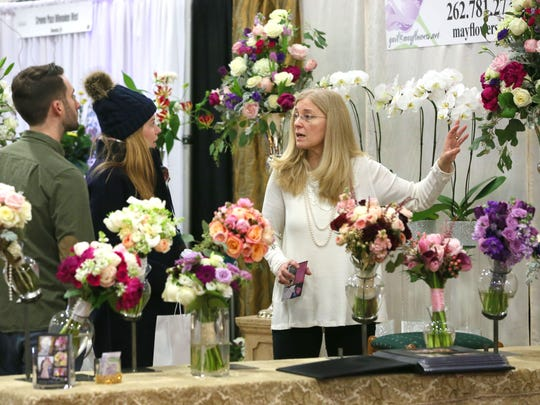 Gail May (right) of Mayflowers in Brookfield talks