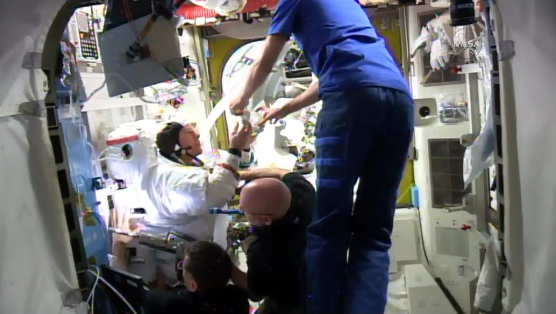 Spacewalk aborted after water leaks into astronaut s helmet for Space station usa