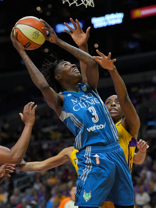 Minnesota Lynx forward Natasha Howard, left, shoots as Los Angeles Sparks center Jantel Lavender defends during the first half in Game 3 of the WNBA basketball finals Friday, Sept. 29, 2017, in Los Angeles. (AP Photo/Mark J. Terrill)