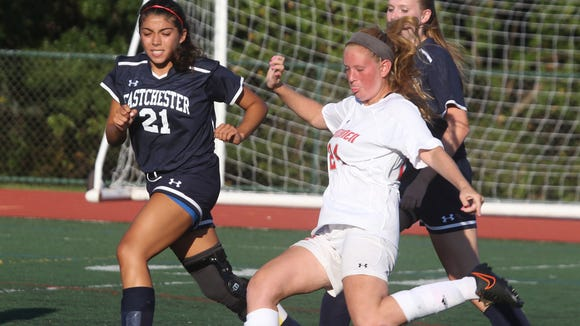 Tappan Zee's Sara Domenick is pressured by Eastchester's Alex Rodriguez (21) during their game at Tappan Zee Sept. 15, 2015. Tappan Zee won 1-0.