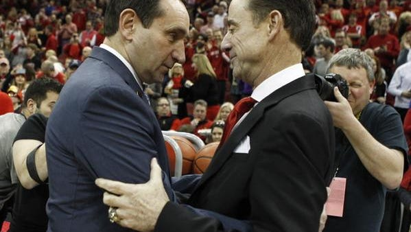 Coach K and Rick Pitino embrace before Saturday's game.