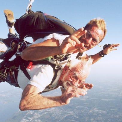 Uwe von Dewitz (top) jumps with Harold Shaffer at SkyDive