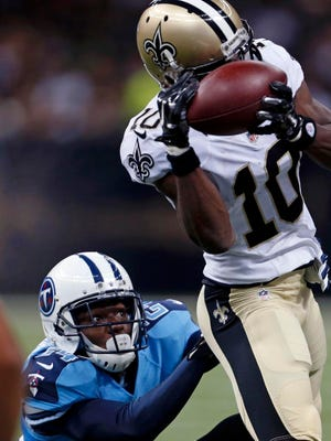 New Orleans Saints wide receiver Brandin Cooks makes a catch over Tennessee Titans cornerback Coty Sensabaugh in the first half on Friday.
