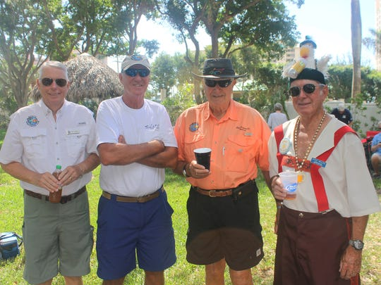 A crowd celebrated Marco's version of Oktoberfest at Sarazin Park on Feb. 21. Above: Jerry Keyes, Paul Milici, Burt Hoell and Dave Walsh.