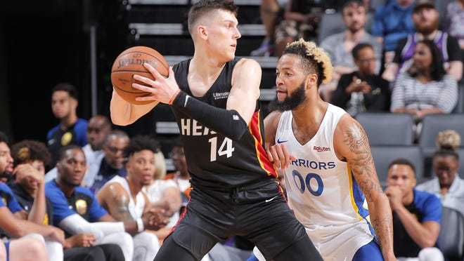 Tyler Herro of the Miami Heat is guarded by Golden State's Ky Bowman during the California Classic on July 3 in Sacramento.