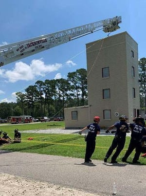 Jacksonville Fire and Emergency Services' Technical Rescue Team members recently conducted Confined Space Entry for their annual requalification. C-shift personnel assisted with setup and rigging of rope system to effect the rescue. The team is made up of 21 specially trained firefighters to respond to critical incidents involving structural collapse, confined space, and water rescue.